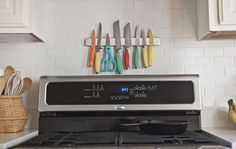 Love these colorful knives mounted on a subway tile backsplash! I am thinking that I need a knife magnet!