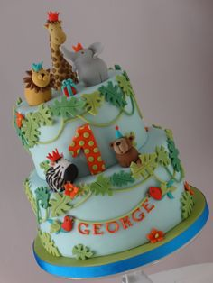 Birthday Cakes - First birthday cake for George.  Had great fun making all the little animals :-)