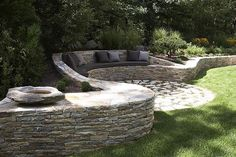 Love the idea of using a wall as a bench! Would be pretty with rock from Minick Materials.