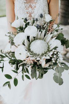 king protea bouquets - photo by Alex Lasota Photography http://ruffledblog.com/modern-rustic-winery-wedding-at-basel-cellars