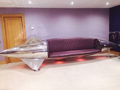 Spectacular couch made from polished Tornado jet fighter drop tank. Aircraft furniture.