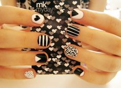 All black-and-white different design on every nail