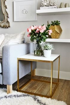 Minimalist white and gold design #sidetabledesign #whiteandgold #moderndesign living room design, modern living room, luxury homes. Find more inspirations at www.coffeeandsidetables.com