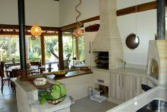 Navegue por fotos de Casas Rústico: . Veja fotos com as melhores ideias e inspirações para criar uma casa perfeita.
