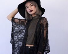 https://www.etsy.com/search/clothing/womens-clothing/sweaters?q=black