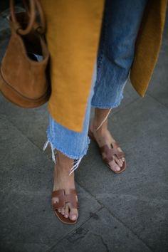 Tan slide sandals.