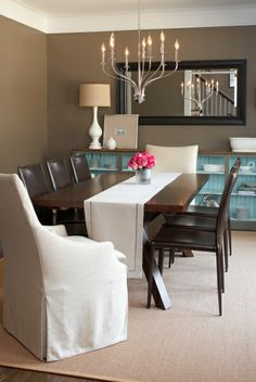 Love this color walls with the pop of aqua in the furniture