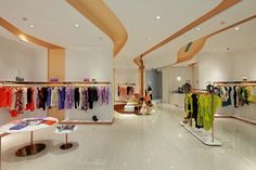Ladies boutique interiors scfashion store by oobiq architects shenyang 02 s Shenyang, Boutique Interior, Clothing Store Design, Clothing Stores, Visual Merchandising, Writing A Research Proposal, Sample Business Plan, Store Interiors, Ladies Boutique