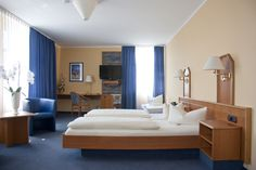 Helle großzügige Komfortzimmer können Sie zu zweit, als Familie oder als Single beziehen.