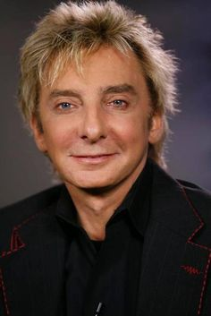 """Barry Manilow comments on his Emmy Award nomination during an interview Thursday, July 6, 2006, at The Capitol Tower studios in the Hollywood section of Los Angeles. """"It's been so long since I've been nominated for anything, I don't know if my tuxedo fits anymore."""" Barry Manilow was nominated Thursday for his performance in a variety or music program. (AP Photo/Damian Dovarganes)"""