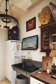 john derian east village apartment via NY times Small kitchen. Art and paintings hung in the kitchen. Gold faucet and sink hardware. Table lamp in kitchen. NYC apartment, Manhattan apartment, New York Apartment, NY apt. Home Interior, Interior And Exterior, Kitchen Interior, Bathroom Interior, Modern Interior, Rustic Kitchen, Kitchen Decor, Kitchen Design, Kitchen Sink
