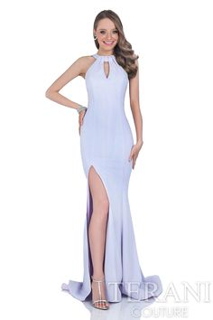 Fitted halter crepe gown with jewel neckline and cutout at the bust. Dress is finished with a bow detail at the back.