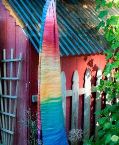 Wrapsody Breeze Hope: a rainbow dances across this wrap, expressing the joy of babywearing in beautiful color.