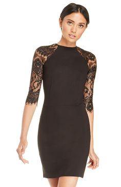 Fitted sheath dress featuring sheer lace raglan sleeves, sheer lace back, and an invisible back zipper with hook and eye closure. By BB Dakota.