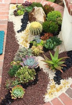 Laura Eubanks, Making some tapestry magic in a very focal little garden entry bed in Bonita, Ca. Photo/Designer Laura Eubanks Design For Serenity We apply a lacquer called Wetlook 2000. Keeps the rocks shiny and bonds them together.