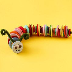 Kids will love creating this adorable caterpillar from chenille stems and a variety of multicolor buttons.                 Make It: Thread a chenille stem through one buttonhole and out through another, twisting in the middle to secure. Have the kids thread assorted buttons in their favorite colors and patterns onto the stem. On the final button, thread the stem back through another hole.