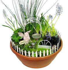 This fairy garden starter kit includes fairy figurine, wire arbor, roll fencing, birdbath, wire bench, watering can and welcome sign. All inclusive multi-p