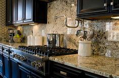 Delicatus White Granite Countertop with Dark Kitchen Cabinets