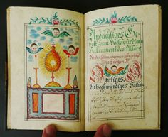 18th C HANDWRITTEN MANUSCRIPT PRAYER RELIGIOUS BOOK MINIATURE PAINTINGS ANGELS in Books, Antiquarian & Collectible | eBay.  This my favorite fraktur manuscript of all that I've found on the Web.