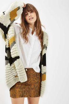 Mix practicality with style in this hand knitted cardigan. Soft-to-touch, it comes in an oversized style with an open front that is perfect for layering. We love the patchwork detailing for a totally casual-cool look. #Topshop