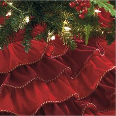 Red ruffled tree skirt with peppermint piping