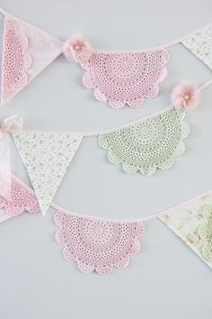 Pretty florals and hand-dyed lace doilies make this bunting perfect for children's rooms, garden parties, tea parties, shabby chic home decoration and birthday parties! Decorated with organza bows and tulle flowers it is a perfect decorative feature for any room or occasion! 10 feet in length.