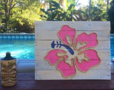 This nautical piece of art is made from reclaimed pallet wood and would be perfect for a nautical inspired beach house! Each sign is hand cut, hand sanded and hand painted. Each sign is made to order so no two will be exactly alike due to variations in the wood. All signs have a cable wire on the back for easy hanging. Dimensions are approximately 24 x 18 inches.