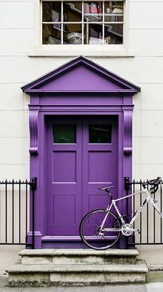 London, England. Like this shade for the front door next to the sea foam green.