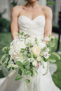 Garden-style wedding bouquet - white + green bouquet of peonies, veronica, roses, hypericum berries, and  greenery {Vivian N Photos}