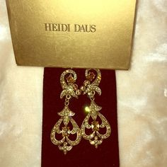 Heidi Daus earrings These are clip on's. They've never been worn. Listed under anthro. For visibility. Anthropologie Jewelry Earrings