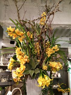 Yellow orchid and calla lily arrangement