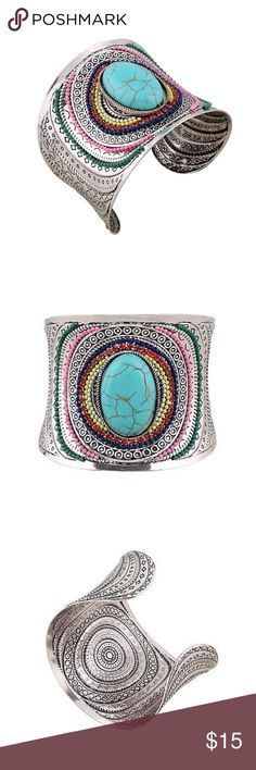 """💥SALE💥NEW Silver Turquoise Cuff Bracelet NEW silver multi-color cuff bracelet with turquoise center. Will fit small-large wrists - more in the larger side but can be adjusted by squeezing it in. Fashion statement bracelet - not sterling silver or real turquoise. 2.25"""" tall, 6.75"""" from end to end. Boutique Jewelry Bracelets"""