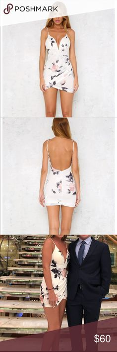 Hello Molly Floral Dress Hello Molly white floral dress. Deep v cut. There is wire in the 'V' so it can be adjusted. Low cut back with zipper. Straps are adjustable. Worn twice. Hello Molly Dresses Mini