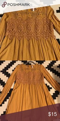 Mustard/Goldish Yellow Dress w/Open Sleeves Never worn on trend color and it's a light rayon material- perfect for summer! The long sleeves aren't real sleeves because they're open so your arms get full ventilation. Modest with a sort of sexy flare. ;-) Xhilaration Dresses