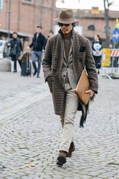 Grey houndstooth topcoat, crewneck sweater, grey blazer, brown suede shoes, casual Friday