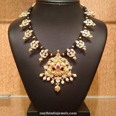 22k gold black thread necklace with ruby and pearls. Indian jewellery designs.