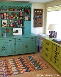 would love to find a hutch to repaint like this for my craft space.  love the green dresser, too.