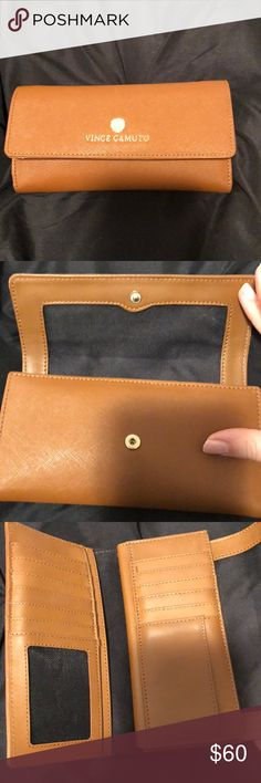 Vince Camuto Wallet Almost perfect condition. Only used for a short period of time. Holds over a dozen wallets/cards, cash and change Vince Camuto Bags Wallets