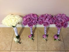 White and lavender bouquets and boutonierres by V
