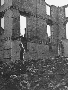 Boy Walking Through Rubble of Building Destroyed by German Bombs During an Air Raid