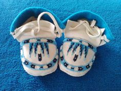 Tiny cute Toddler moccasins made by Mary Spottedbear