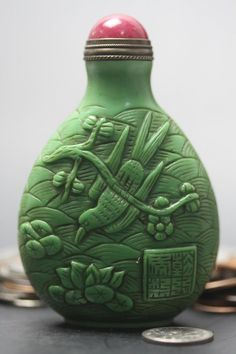 Fine Chinese Antique Carved Lotus and birds Green Glass Snuff Bottle 18th C.