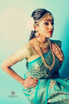 A south Indian bride in a sky blue and gold silk sari. Definitely a great choice!