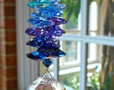 """Crystal Ball Ornament, Suncatcher, Prism, Clear Swarovski Crystal Ball and Swarovski Crystal Octagons in Peacock Colors """"NIRVANA"""" by HeartstringsByMorgan Swarovski Crystal Beads, Crystal Ball, Crystal Lights, Peacock Colors, Peacock Feathers, Hanging Crystals, Diy Crystals, Ball Ornaments, Sun Catcher"""