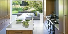 If you've got the view, flaunt it. This contemporary kitchen by Chamber Furniture teams flat-fronted wood units with a traditional range cooker and a long island for easy prep. Custom Made Furniture, Furniture Design, Sliding Glass Door, Glass Doors, Range Cooker, Family Kitchen, Bespoke Kitchens, Kitchen Extensions, Indoor