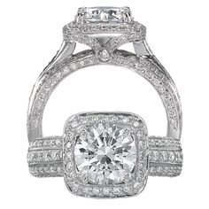 Masterwork diamond engagement ring featuring a cushion halo with a round cut centerstone with surrounding micropavé diamonds and three rows of micropavé diamonds on the shank.   This is it.