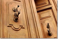 Mythological dragons infused on the door knobs of Rome