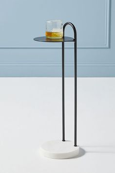 Featuring a modern, steel-crafted design with a touch of timeless marble, this end table is a sophisticated perch for mixed drinks and cocktails. Unique End Tables, Side Tables, Travertine Coffee Table, Hanging Furniture, Living Room End Tables, Engineered Hardwood, Mixed Drinks, Adjustable Shelving, Design Crafts