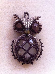 My beaded Owl Pendant.  You can make him too. Classes at Bead & Art Studio    www.     beadandart.com