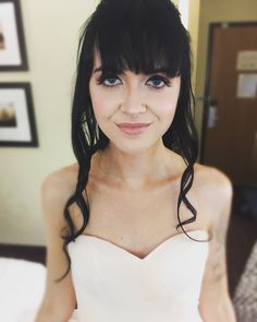 Wedding Hair And make up on my bridal client. Vintage, eyelashes, bangs and long curls.